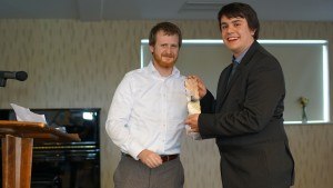 Richard receiving his award from Dr Kyle Erickson, Assistant Dean of the Faculty